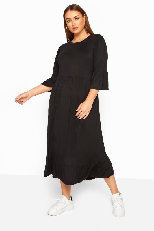 LIMITED COLLECTION - Aangerimpelde midi-jurk in zwart