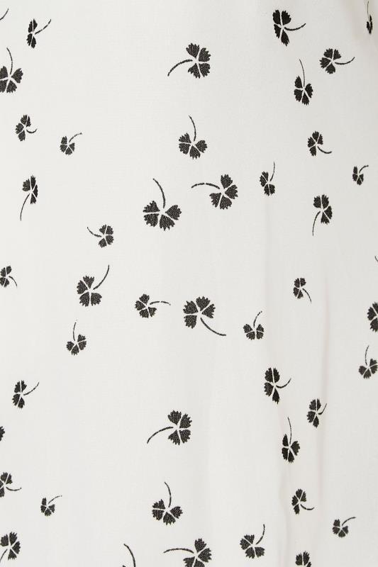 Black Clover Print Short Sleeve Dipped Hem Blouse_S.jpg