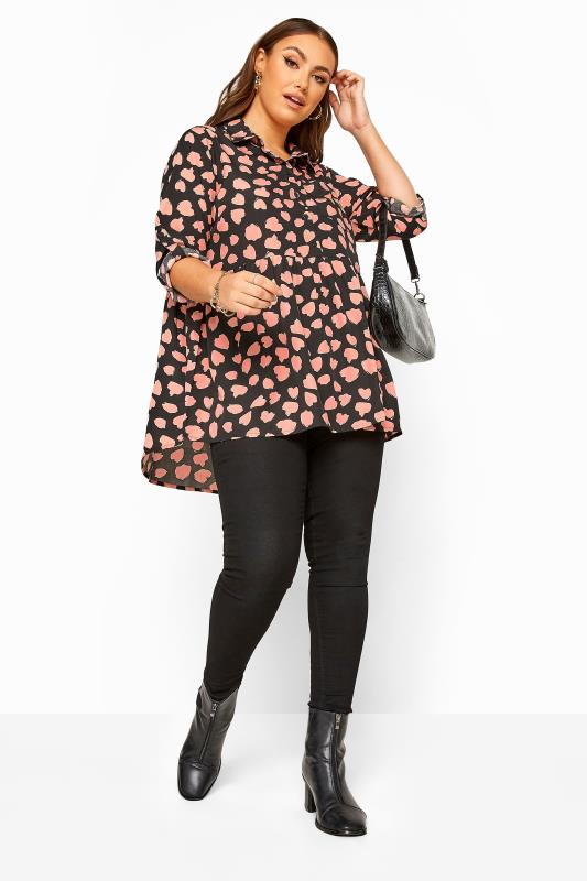 Black Abstract Heart Peplum Dipped Hem Shirt