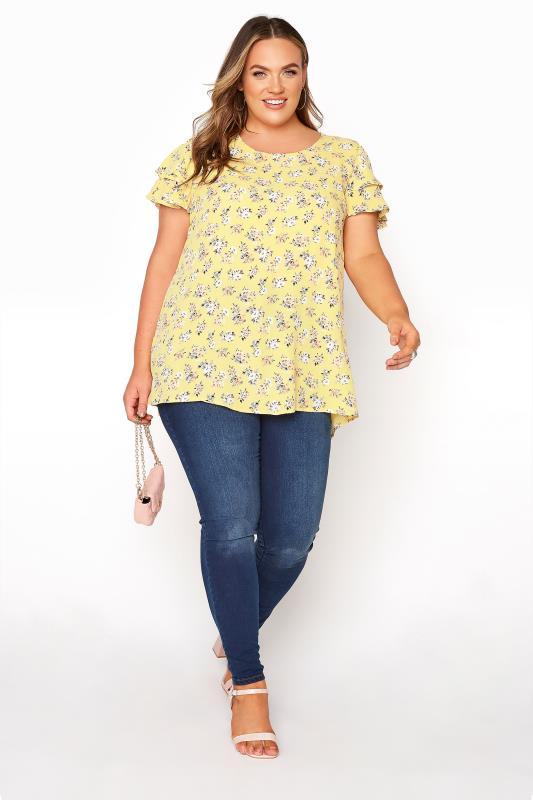 Yellow Floral Print Dipped Hem Blouse_B.jpg