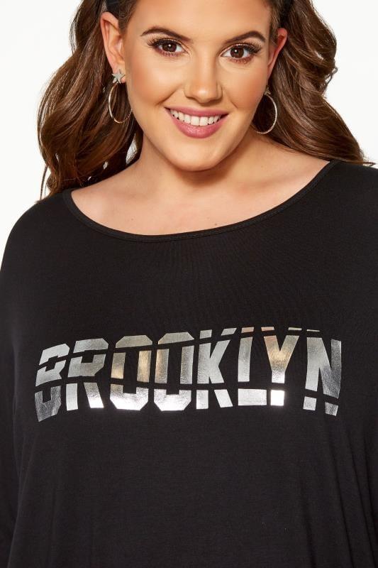Black 'Brooklyn' Foil Slogan Extreme Dipped Hem Top