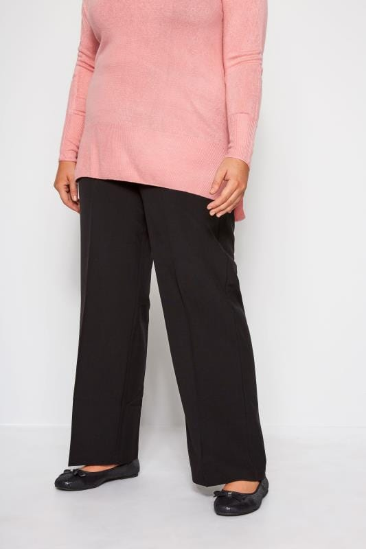 Pantalones rectos Tallas Grandes Pantalones clásicos en color negro con pernera recta y cinturilla elástica
