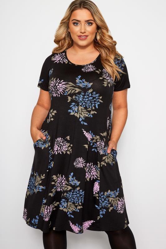 jerseyjurken Zwarte jersey jurk met bloemenprint en zakken