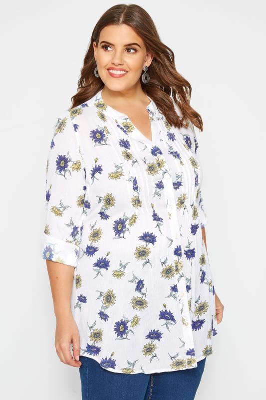 Wit-blauwe longline blouse met bloemenprint & pailletten