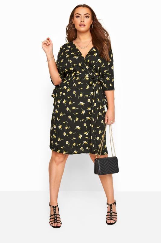 Midi-jurk met gele bloemenprint en strikjes aan de mouwen in zwart