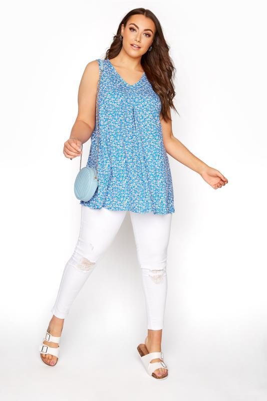 Kobalt Blaues Swing Top mit Gänseblümchen