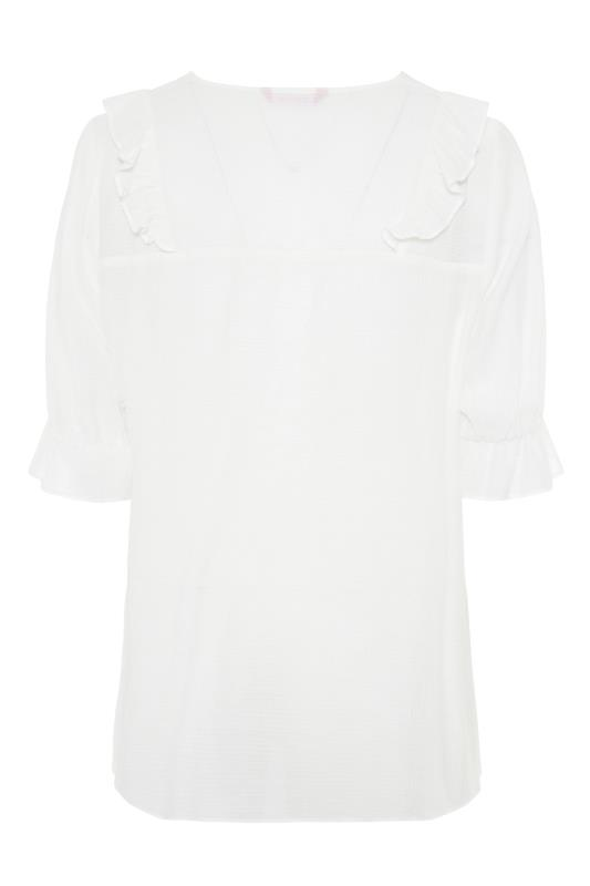 THE LIMITED EDIT White Button Frill Blouse_BK.jpg