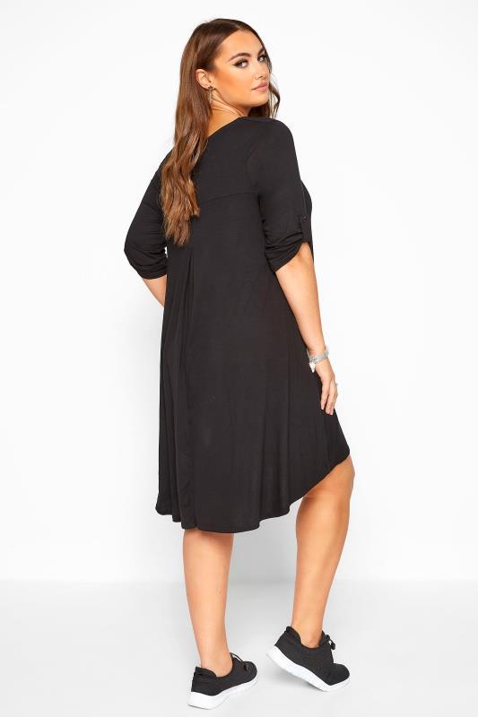 Black Dipped Hem Swing Dress
