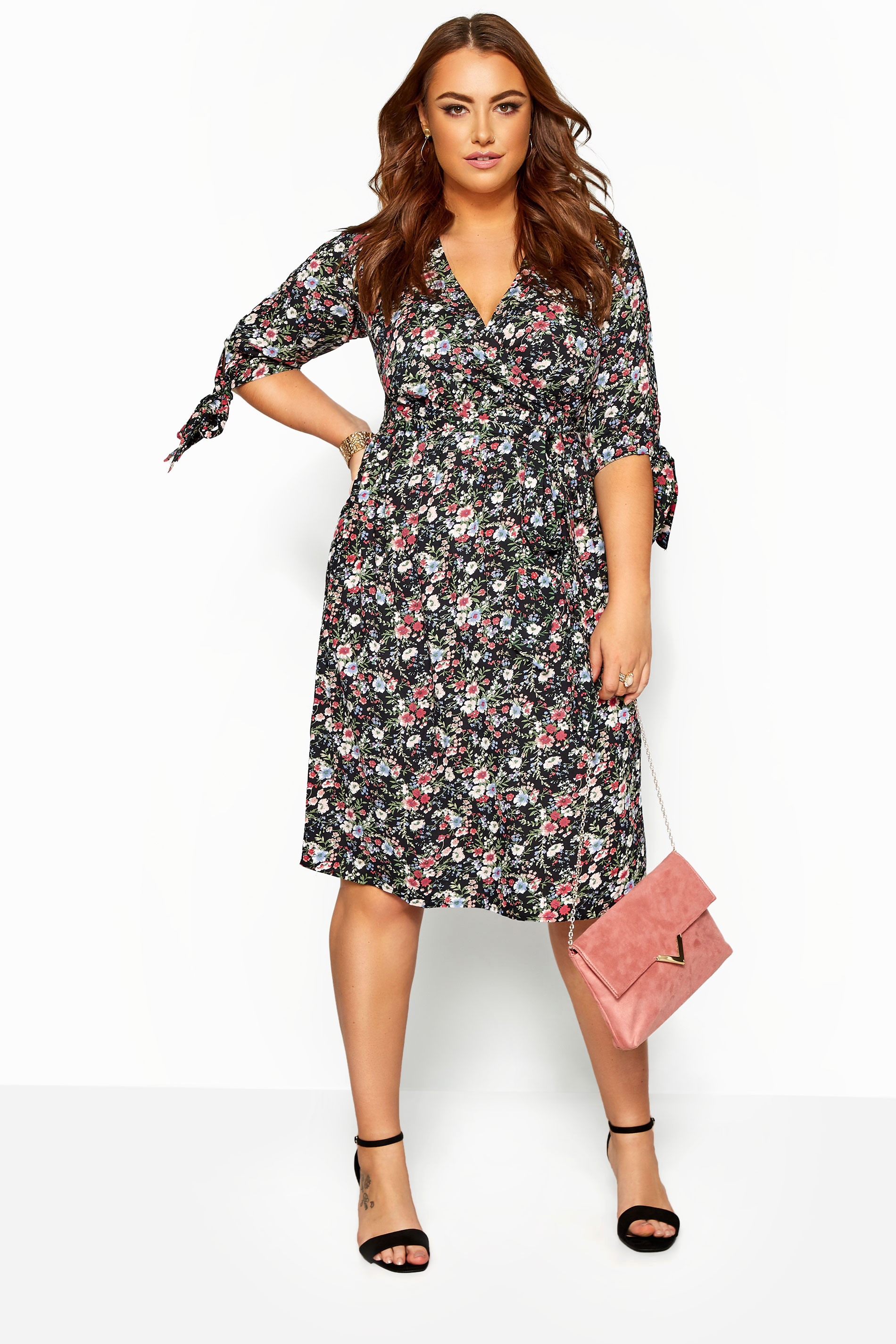 Midi-jurk met bloemenprint en strikjes aan de mouwen in zwart
